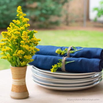 flowers with plates and napkins outside