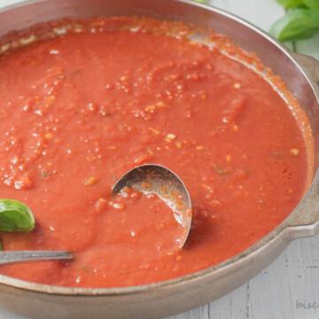 pan of san marzano sauce with ladle
