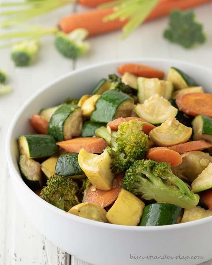 smoked vegetables in bowl with more behind