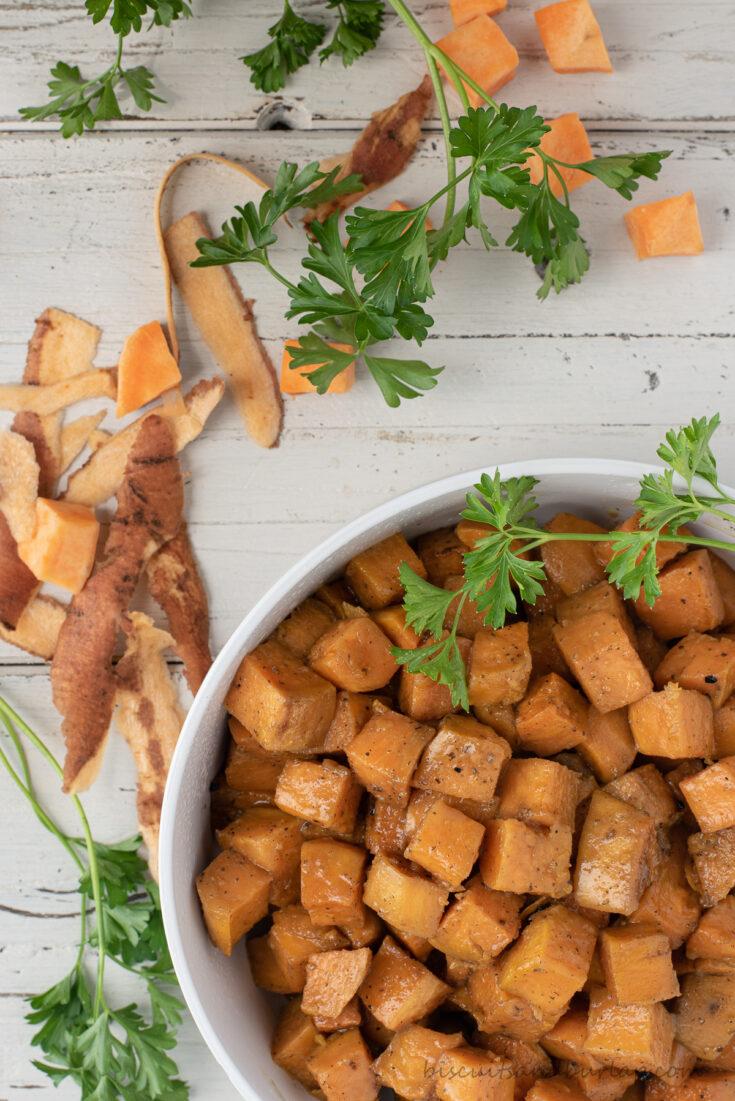 bowl of sweet potatoes in corner with peelings