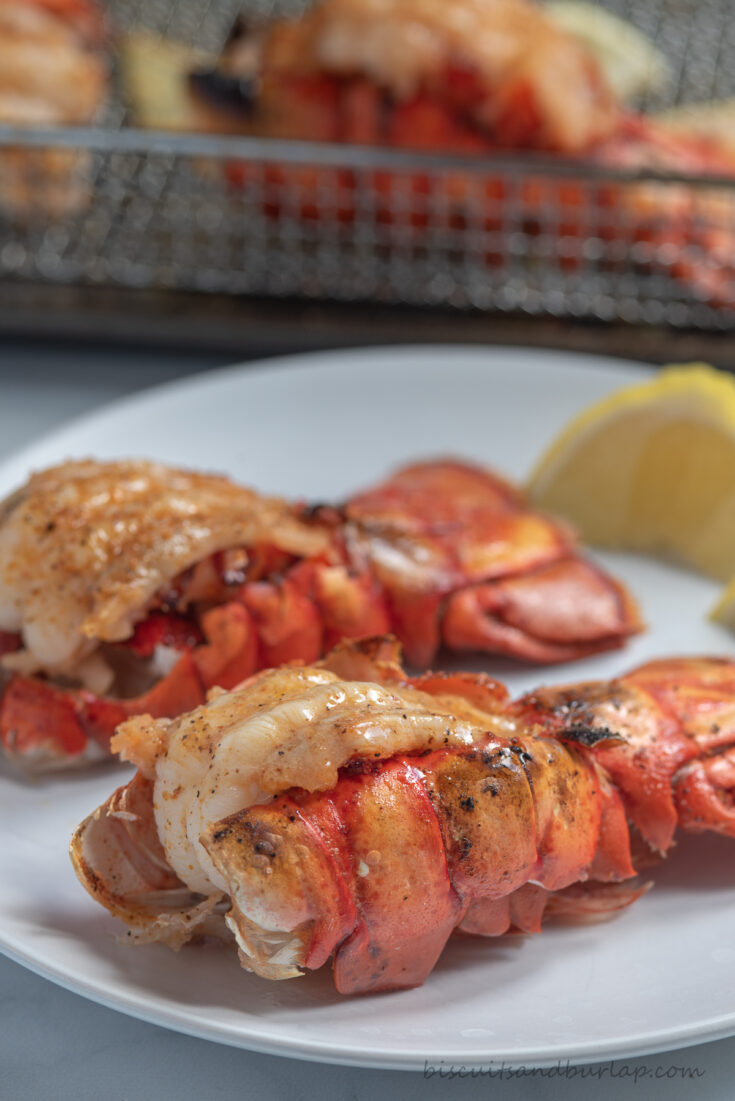 two air fryer lobster tails on plate