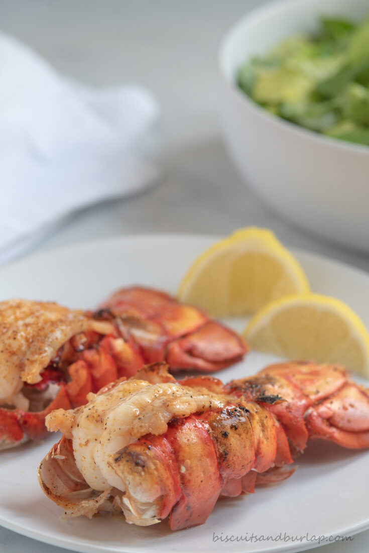 two air fryer lobster tails with lemon
