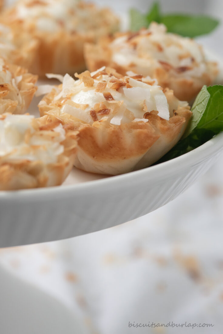 coconut tartlets on white stand