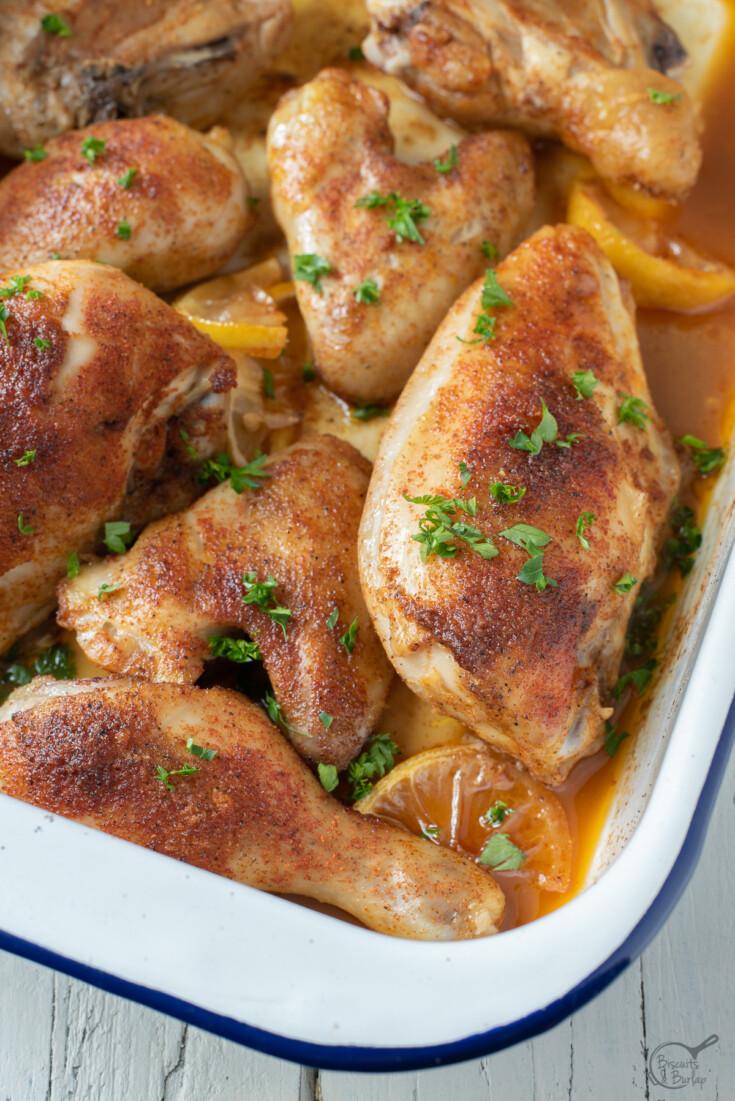 cajun baked chicken in pan